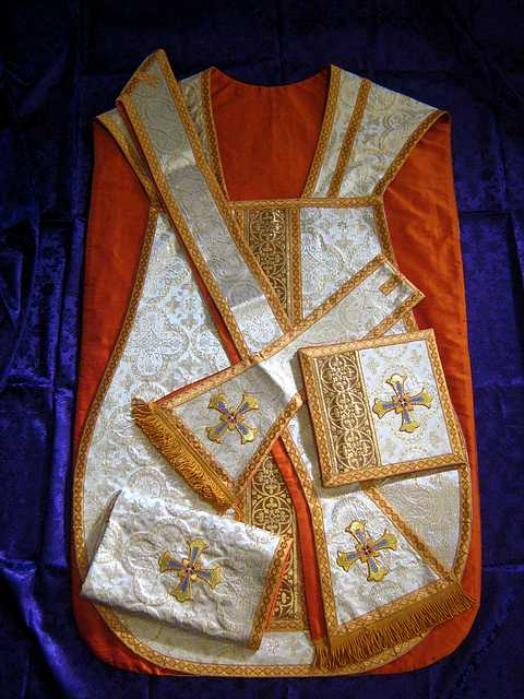 Beautiful Roman vestment design in white/gold metallic fabric.